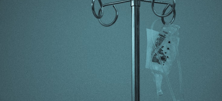 A photo of a bag of dextrose hanging on an IV pole.